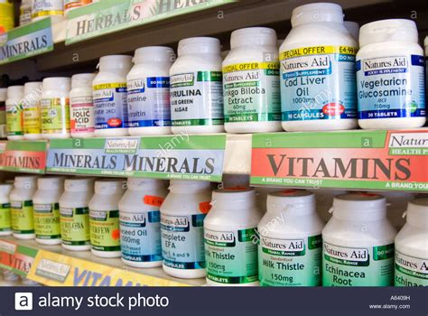 Vitamin Supplement rows of vitamin pills and food supplements in health store