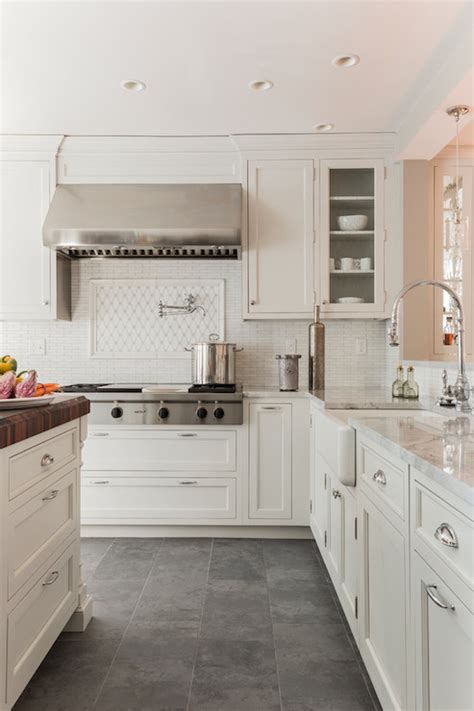 White Kitchen Cabinets Tile Floor White Cabinets Paired With Supreme White Quartzite Countertops Venegas And Company