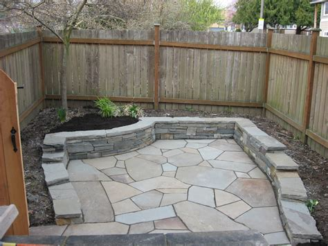 flagstone patio with retaining wall yard