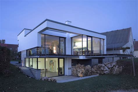 split level houses glass walls balcony evening lighting contemporary split