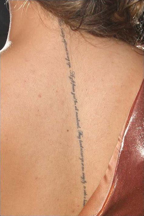 tattoo lettering down spine close up of leona lewis spine tattoo via google images i