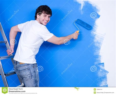 paint man happy man painting the wall stock image image 13994141