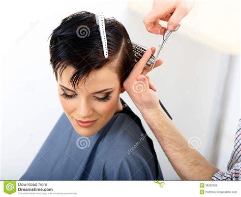 Hair. Hairdresser Cutting Woman Hair In Beauty Salon