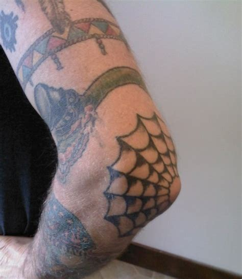 spider web on elbow tattoo images designs