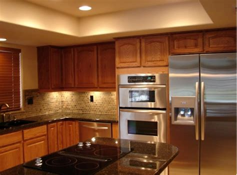 kraftmaid fawn oak cabinets with granite countertops