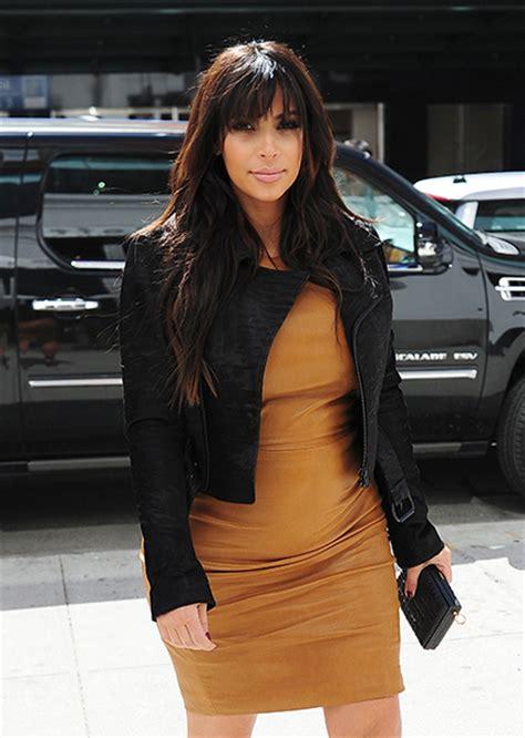 kim kardashian mustard dress kim kardashian says being a mum is so crazy