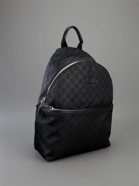lyst gucci embossed monogram backpack in black