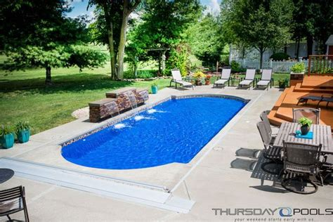 backyard leisure pools this backyard has a cathedral fiberglass pool design by