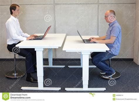 Leaning Back In Chair Posture by Two Working In Correct Sitting Posture On Pneumatic