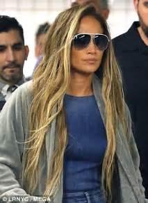jennifer lopez sports long blonde hair and double denim