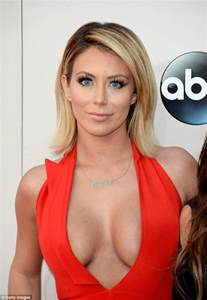 aubrey o day wears yet another cleavage enhancing dress to
