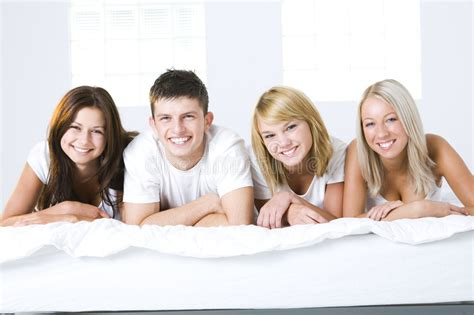 friends with the my bed friends in bed stock photo image of leisure friendship