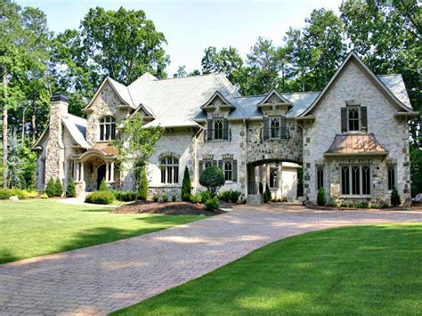 house plans that look like old houses old world style home with arched porte cochere like
