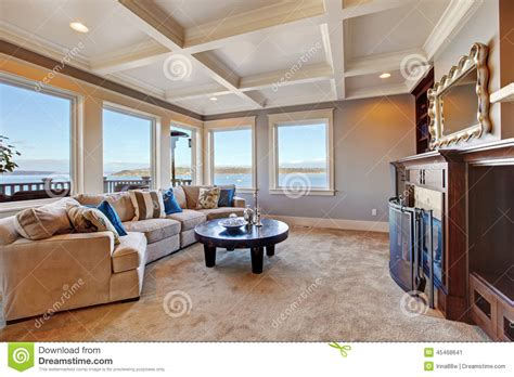 White Wine On Carpet by Warm Living Room Interior In Luxury House With Puget Sound