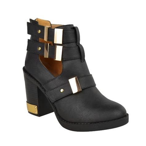 lea black cut out ankle boots with gold buckle detail