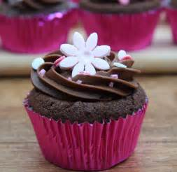 Chocolate Cupcake Decorations by Chocolate Cupcakes With Pink Flower Decorations