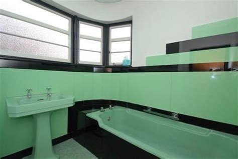 art deco bathroom with aqua and black vitrolite tile