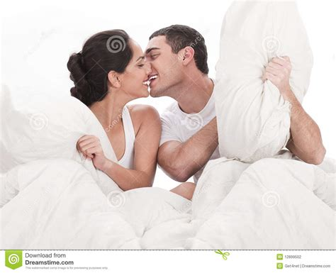 kissing on the bed couple kissing and playing on bed stock photography