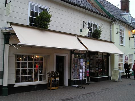 store awnings traditional pull down shop awnings