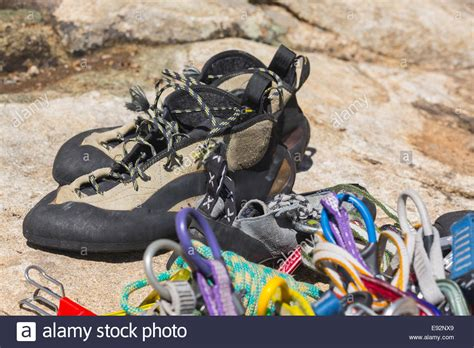 rope climbing shoes up of rock climbing shoes ropes and carabiners