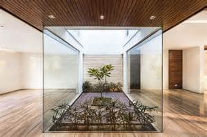 Indoor Courtyard by A Sleek Modern Home With Indian Sensibilities And An