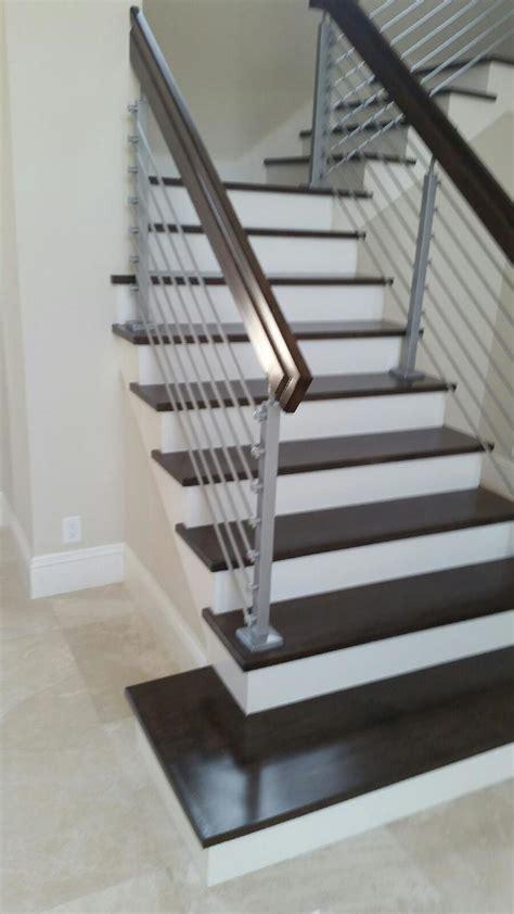 Staircase refinishing, real hardwood or laminate custom