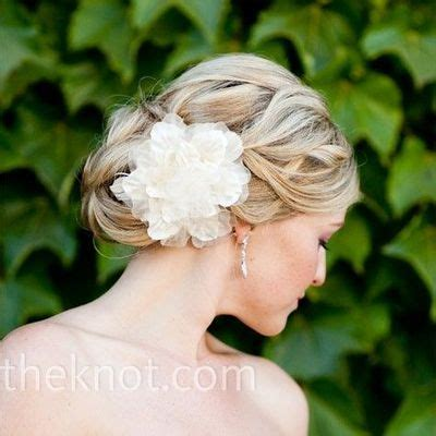 bridal hairstyles low bun with flowers wedding hair braided curly low bun with flower