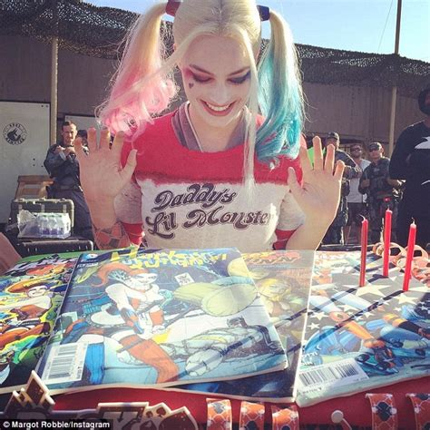 themes in her film margot robbie s suicide squad cast mates surprise her with