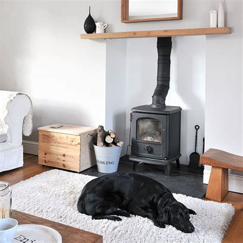 living room stoves white living room with woodburning stove