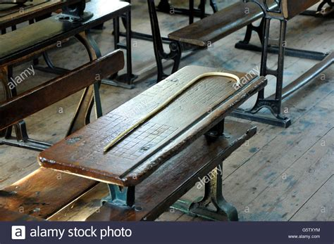 punishment bench victorian school bench and punishment cane stock photo