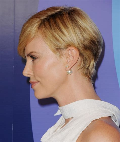 haircuts to cover scar charlize theron glows covers neck surgery scar with scarf