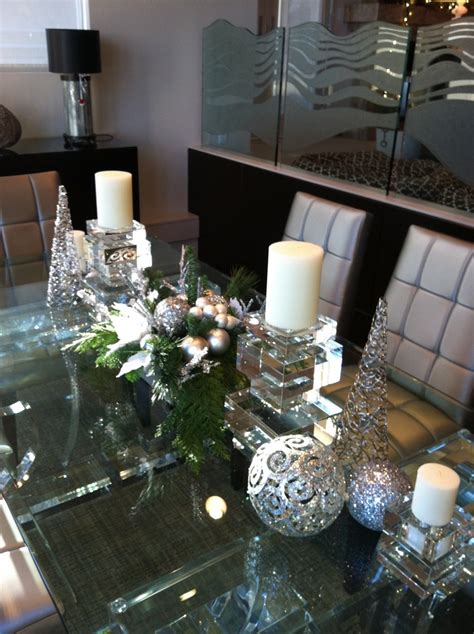 centerpiece in silver with evergreens and candles