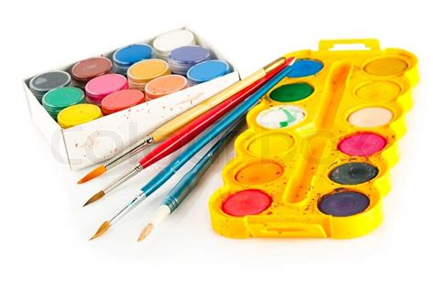 set for painting palettes of watercolor paint and used brushes on white background sdof