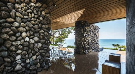 a tolan house is a seafront home built with rocks