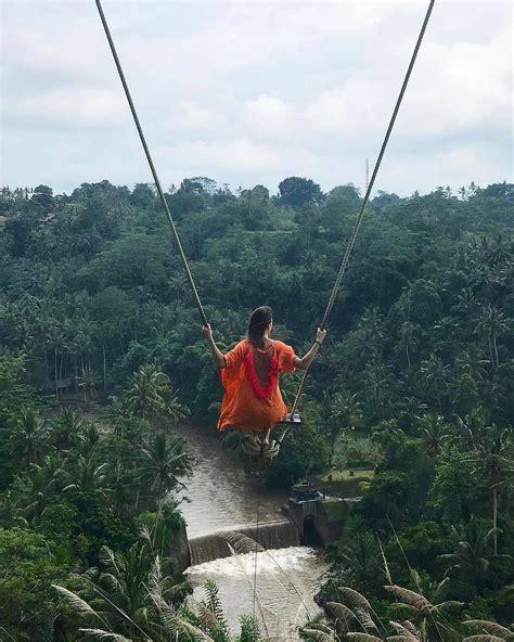 swing bali swinging in the wood ubud bali indonesia photo