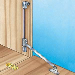 Stopmatic drop front support with catch cabinet and furniture door