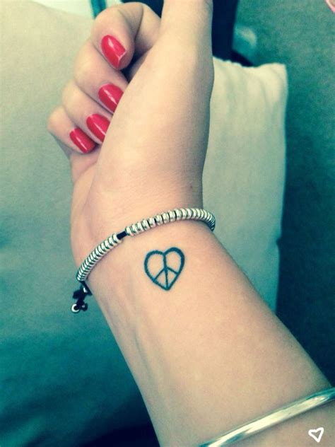 small peace tattoo 36 classic peace symbol wrist tattoos design
