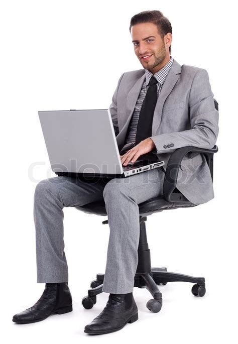Person Sitting At A Desk by Business Sitting With Laptop And Smiling At Office Desk Isolated White Background Stock