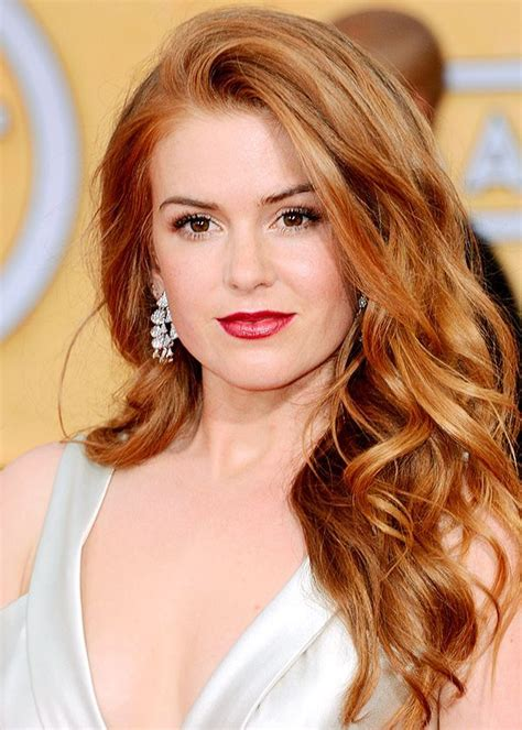 actress with bright red hair light red hair paired with a white dress can t go wrong