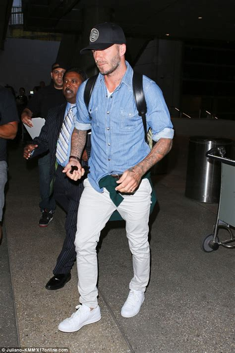 Dave 143 Denim Combination Black David Beckham Dons Jean Shirt And White Trousers As He