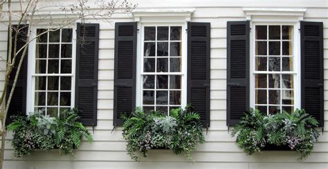 Custom House Design window boxes and black shutters charleston sc spencer