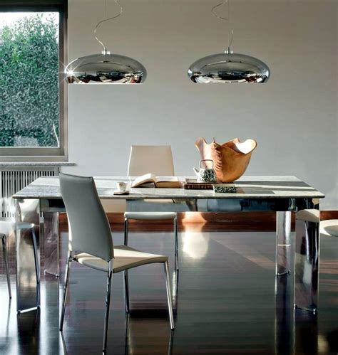 Two pendant lights on chrome dining table   Interior