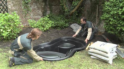 installing a backyard pond installation of a ready made pond youtube