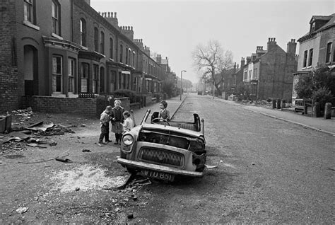 Old Couple On Porch by Powerful Photos Of Manchester Slums 1969 72