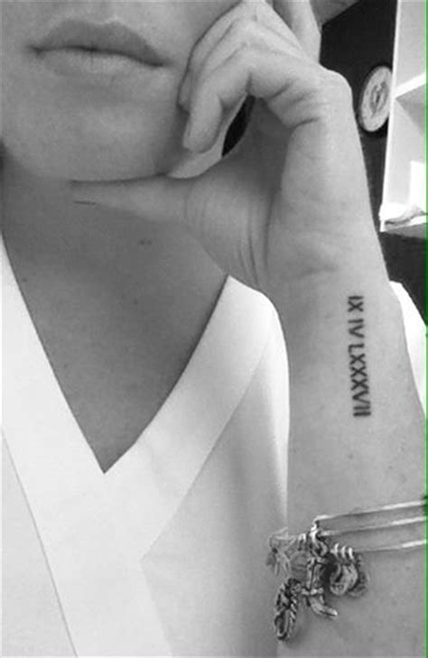 roman numeral tattoos on wrist wrist numeral tattoos