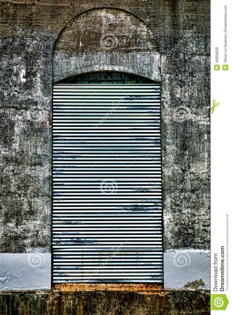 security curtains steel curtain security door on abandoned factory stock
