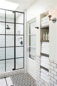 bathroom alcove shelves pink rug on black and white cement tile bathroom floor