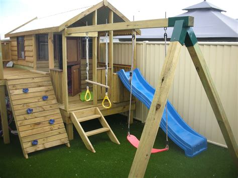 cubby house with slide and swings quality timber cubby houses for your backyard