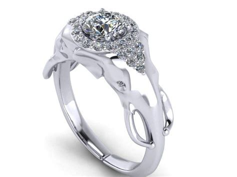 elephant engagment ring with half carat center and