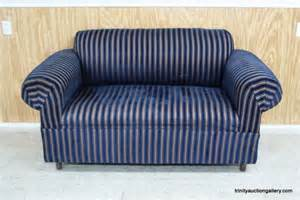 navy blue gold striped seat sofa